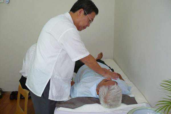 Master Tan treating patient